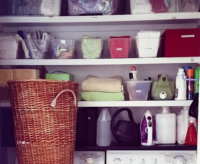 organized laundry cupboard
